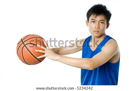 A teenage boy in blue sports vest and shorts with a basketball on white background