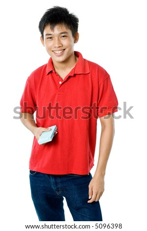 A teenage boy in red holding a portable video game on white background