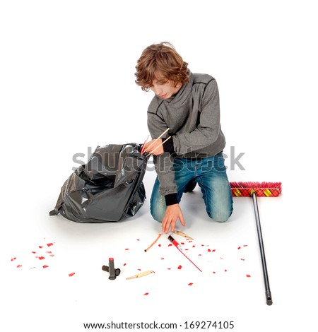 a teenage boy is cleaning up the mess on new years day - stock photo