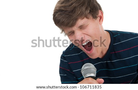 A teenage boy singing into a microphone on a white background - stock photo