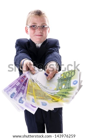 A teenage boy wearing a dark suit and tie, holding a bunch money into the camera,isolated against white background - stock photo