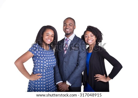 A teenage brother and his teenager sisters dressed up isolated on white - stock photo