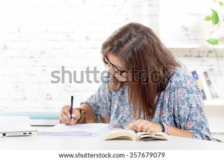 a teenage girl doing her homework - stock photo