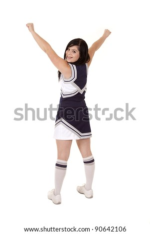 a teenage girl in her cheer outfit with a smile on her face and her arms up in the air.