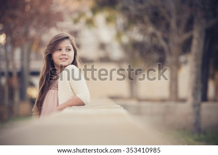 a teenage girl in the autumn, in a park - stock photo