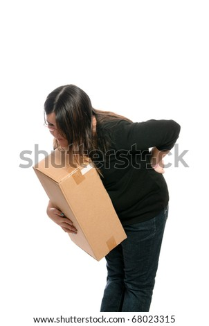 A teenage girl injured her back while trying to lift a box, isolated against a white background. - stock photo