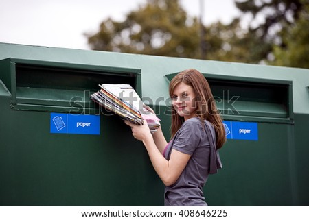 A teenage girl recycling magazines - stock photo