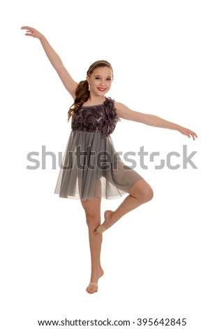 A Teenage Girl Smiling as she Poses in Lyrical or Modern Dance Style