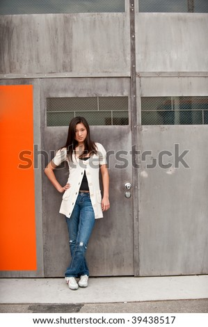 A teenage girl standing in front of a colorful background - stock photo
