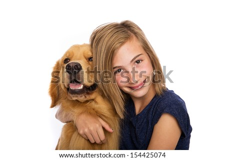 A teenage girl wearing headgear sits with her golden retriever dog