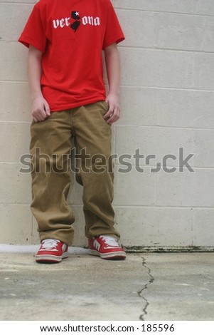 A Teenager against a wall. - stock photo