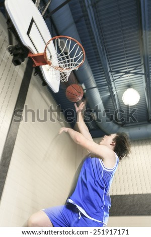 A teenager basketball player play his favorite sport - stock photo
