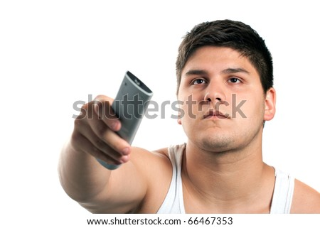 A teenager changes the channel with the remote control isolated over a white background. Shallow depth of field. - stock photo