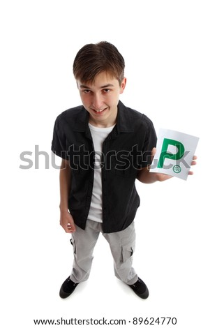 A teenager holds the green magnetic provisional  P plates for vehicle.  White background. - stock photo