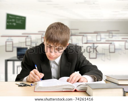 A teenager studying hard for the exam - stock photo