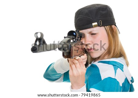 A teenager with a gun on a white background. - stock photo