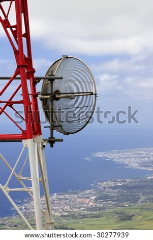 A telecommunication tower with the sea on the background (Azores) - stock photo