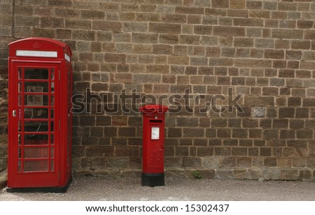 a telephone box and a post box - stock photo