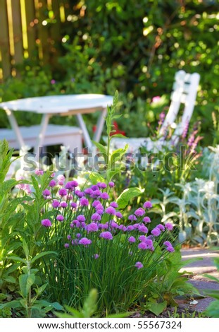 A telephoto of White Garden table and chairs - stock photo