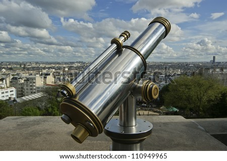 A telescope viewer overlooks view Paris skyline from the Sacre-CÃ?Â??ur Basilica, France