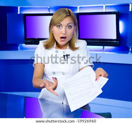 a television anchorwoman at a studio is shocked by news she has in her hands