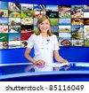 a television anchorwoman at studio, a multidisplay panel behind, collage of photos by the author - stock photo