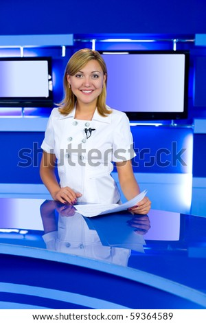 a television anchorwoman at studio, looks into camera