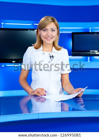 a television announcer at studio during live broadcasting - stock photo