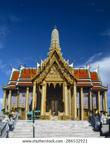 A temple at the Grand Palace Bangkok Thailand on a beautiful clear morning.