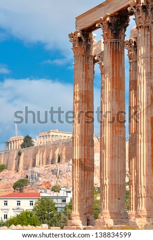A Temple of Olympian Zeus and Acropolis with Parthenon in the background , Athens , Greece . - stock photo
