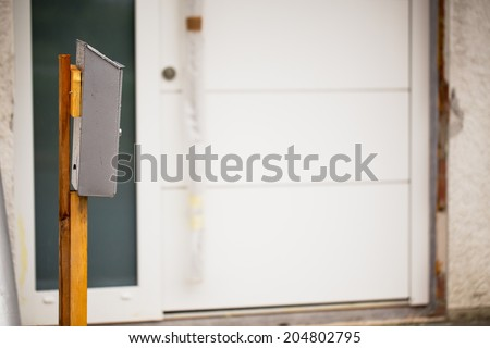 A temporary mailbox in front of a newly built house - stock photo