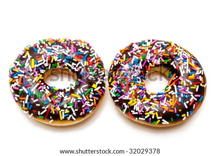 A tempting donuts with chocolate icing and colorful sprinkles, isolated on a pure white background. - stock photo