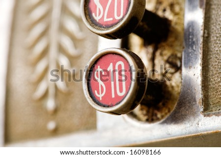 A ten dollar button on a retro cash register - shallow depth of field.
