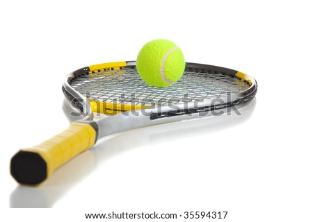A tennis ball and racket on a white background with copy space