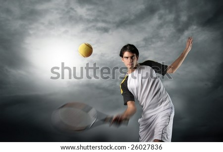 a tennis player in action with a cloudy sky - stock photo