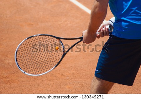 A tennis player waiting for a serve during a match - stock photo