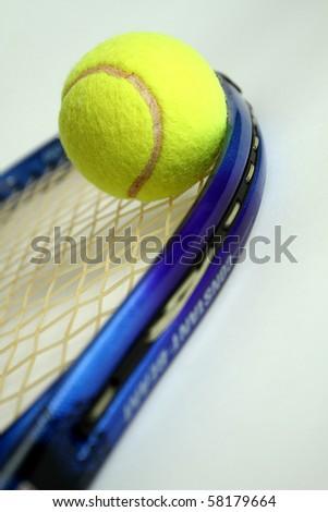 A tennis racket and tennis ball - stock photo