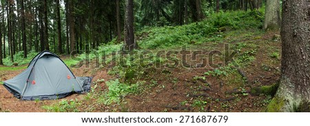 A tent in a wilderness area, meadow, trees. This panoramic landscape is an very high resolution multi-frame composite and is suitable for large scale printing. - stock photo
