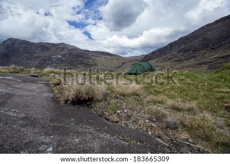 A tent in the Scottish Highlands.  - stock photo
