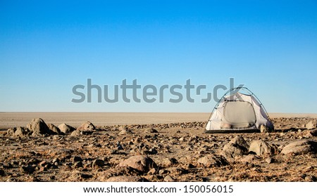 A tent pitched overlooking the makgadikgadi pans in Botswana - stock photo