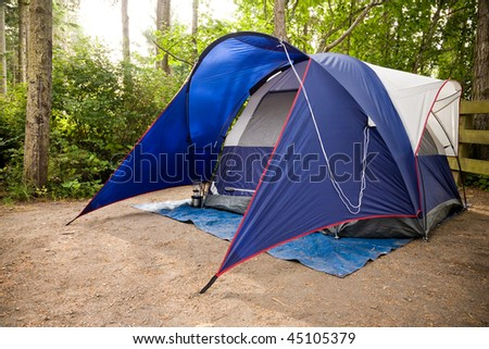 A tent set up in a campground in the Pacific Northwest. - stock photo