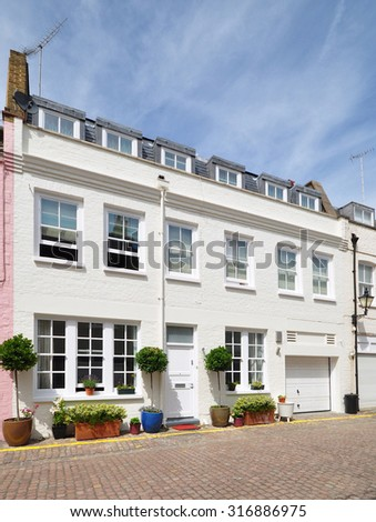A terraced mews house converted from an eighteenth century stable carriage building, in Kensington, London, UK. - stock photo