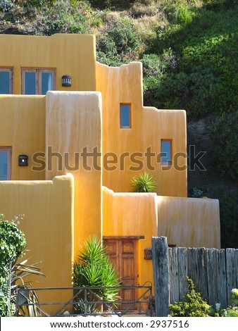 A terracotta colored house with Mexican design - stock photo
