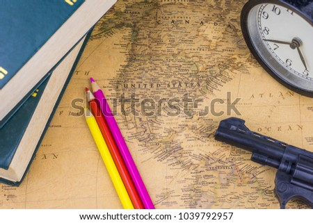 Text book color pencil gun alarm stock photo 1039792957 shutterstock a text book color pencil gun and alarm clock on a world map of gumiabroncs Image collections