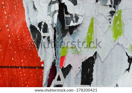 a textured background image of torn layers of posters - stock photo