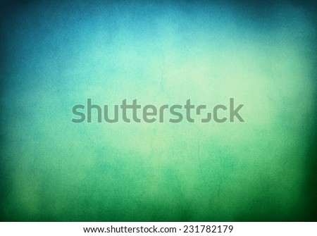 A textured grunge background with a green to blue gradient.  Image displays significant paper grain and texture when viewed at 100 percent. - stock photo