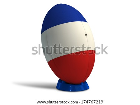 A textured rugby ball in the colors of the french national flag on a kicking tee on a isolated white background - stock photo