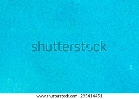 A textured soft blue watercolor background with salt spots. Watercolor on cotton paper. - stock photo