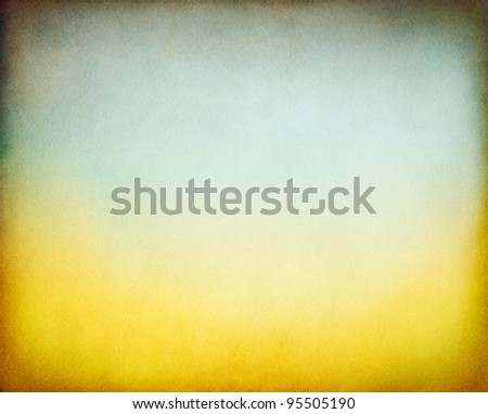 A textured, vintage paper background with a yellow to subtle green toned gradient. - stock photo