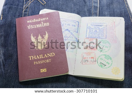 a Thailand passport in pocket of jeans - stock photo